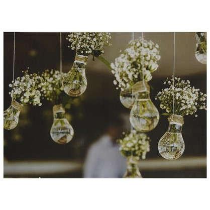 Картина на холсте 50х70 см Цветы в лампочках цена